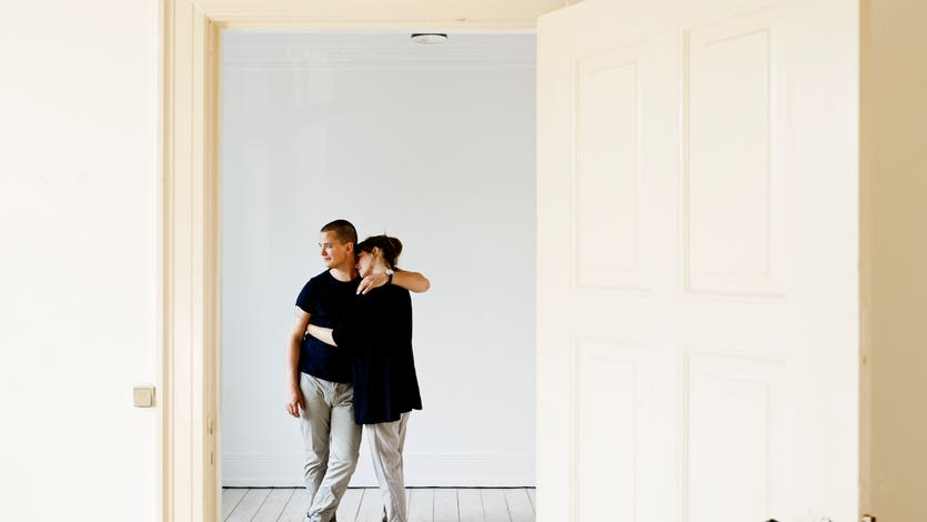 A couple embraces in their newly bought home