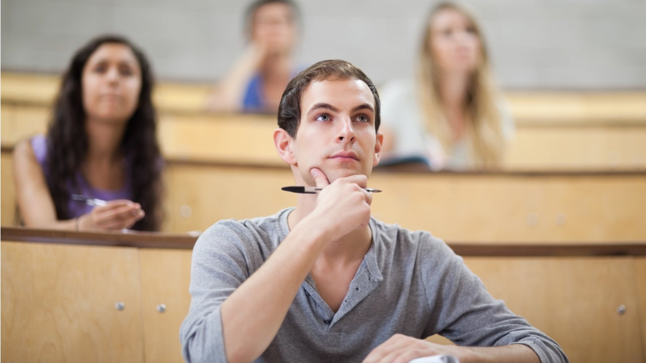 College student sits in a lecture hall