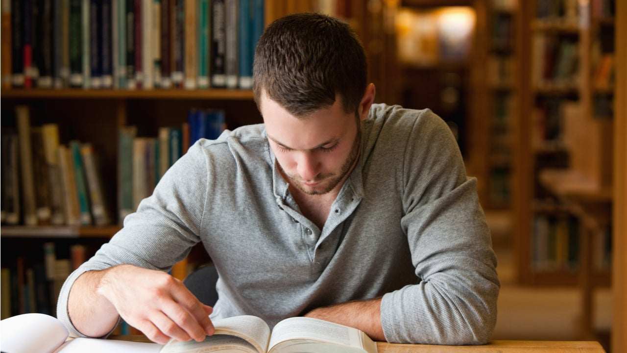 Man studies in a college library
