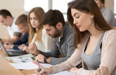 Students work on assignments in college classroom
