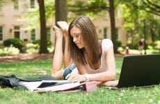 College student studies outside