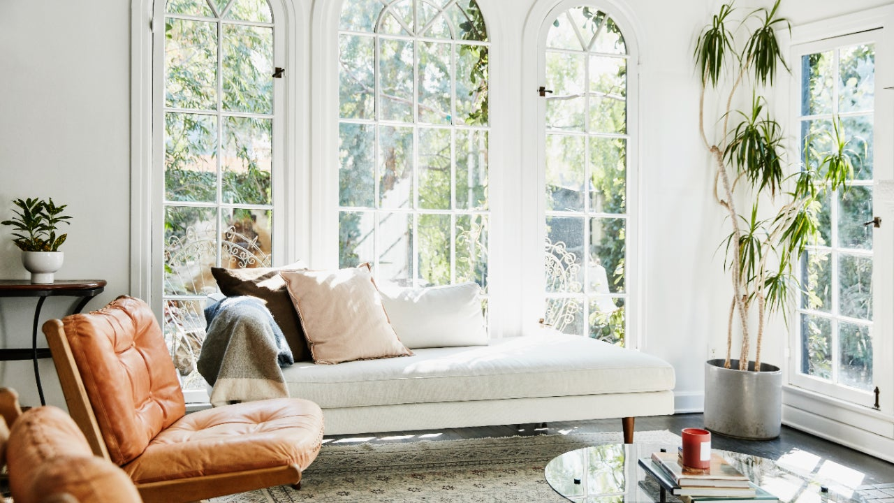 View of a sunlit living room with white walls