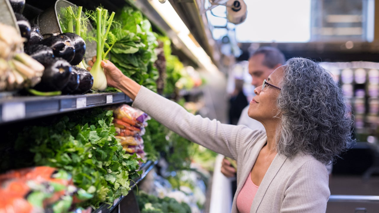 Woman at grocery store in produce section