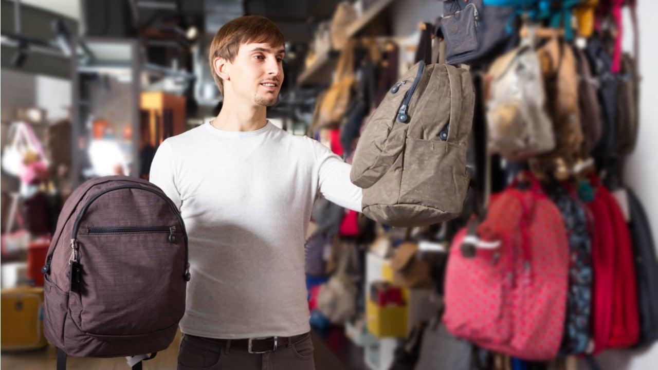 Man shops for backpacks