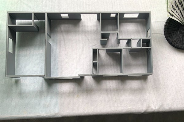 A mini 3D model of the house printed in 3D.