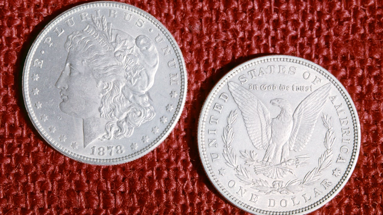 A picture of the front and back of a Morgan silver dollar