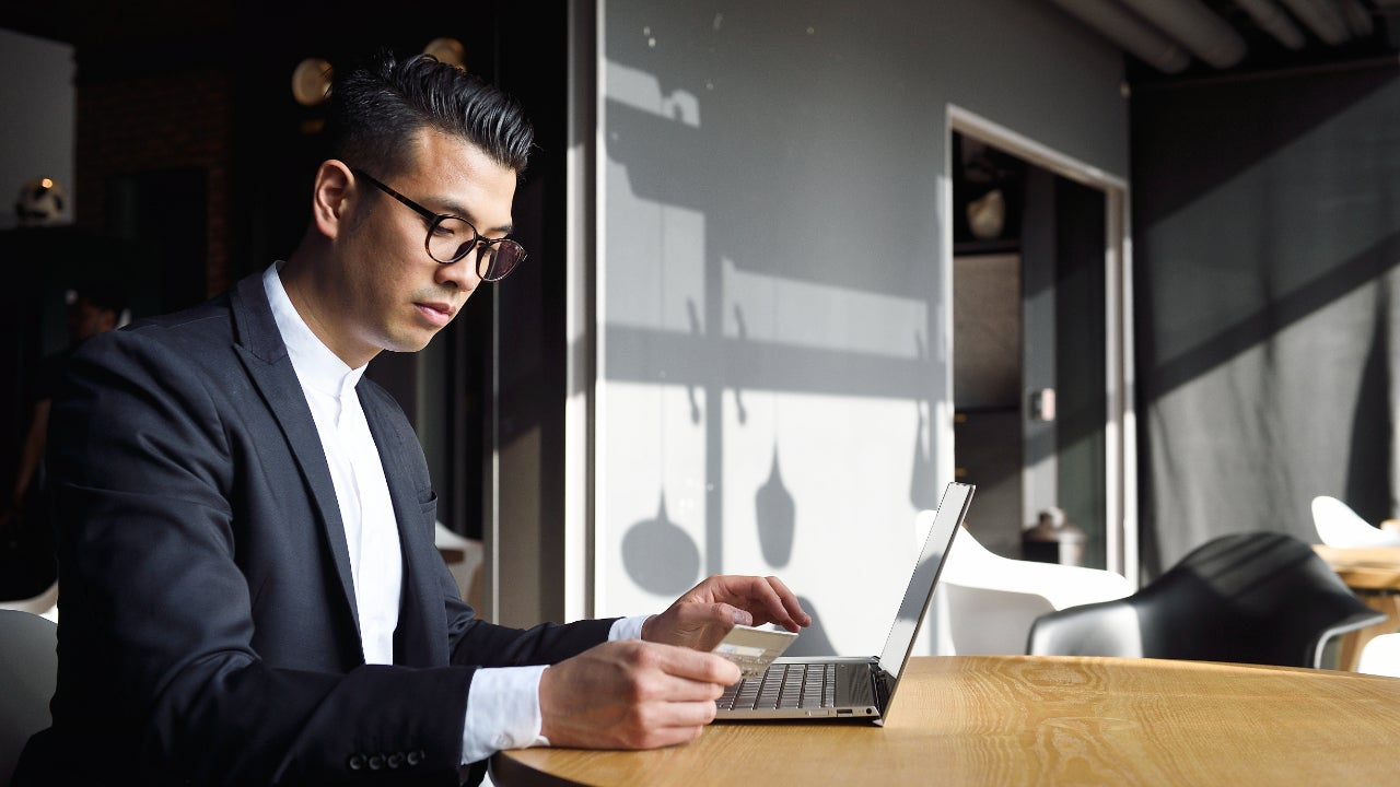 Business man with credit car and laptop