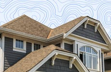 A house roofline in front of a graphic background.