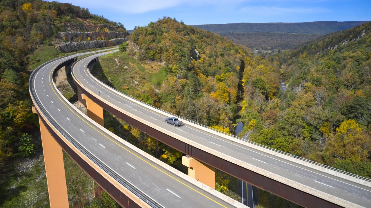 USA, West Virginia, Aerial view ofU.S. Route 48 bridge stretching over Lost River inAppalachian Mountains