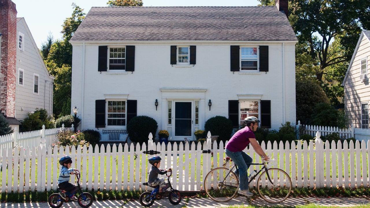Family biking outside of suburban home