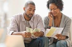 Black couple paying bills