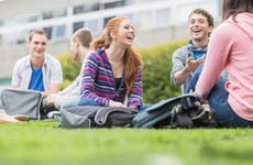 College students sit on college campus