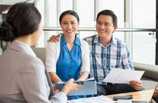 Couple meets with a financial advisor
