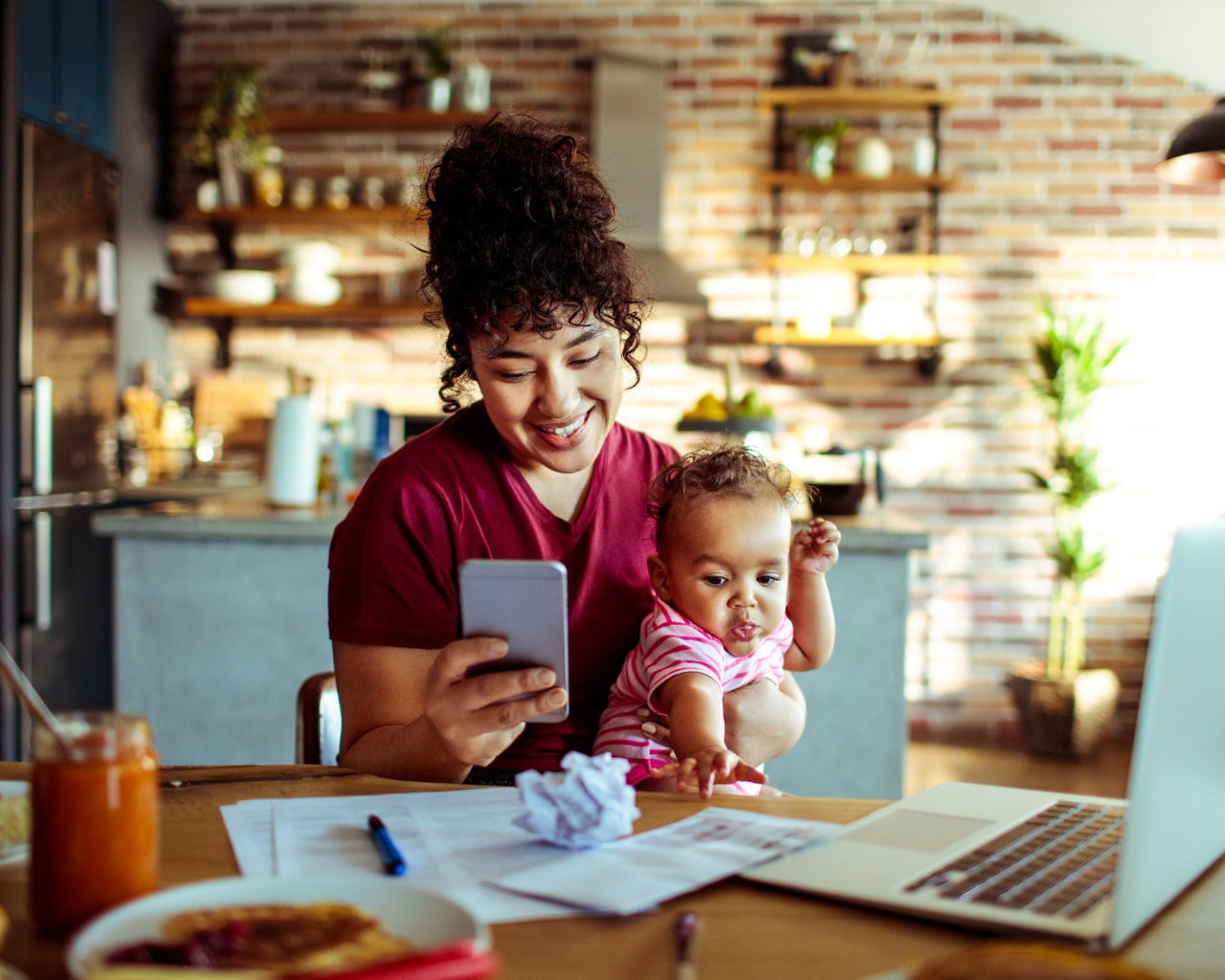 Young mother with baby and smartphone