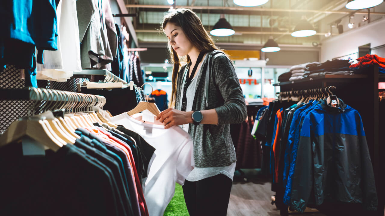 Woman shopping at clothing store