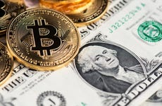 Bitcoin and one-dollar bill side by side