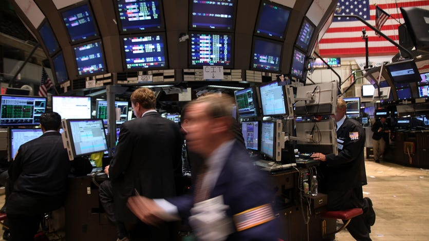 A picture of the stock market floor with traders.