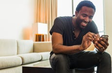 Man using cell phone in living room