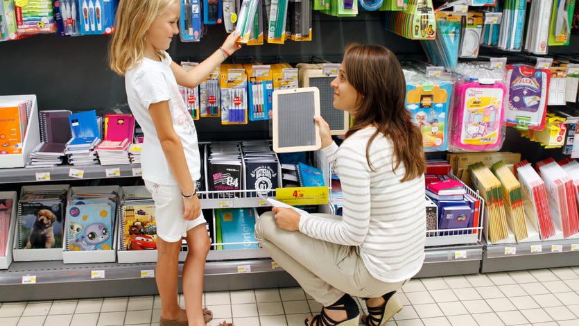 A parent and child shop for school supplies.