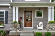 Front porch and entrance to a newly built home. The address, 719, is above the door in a modern font.
