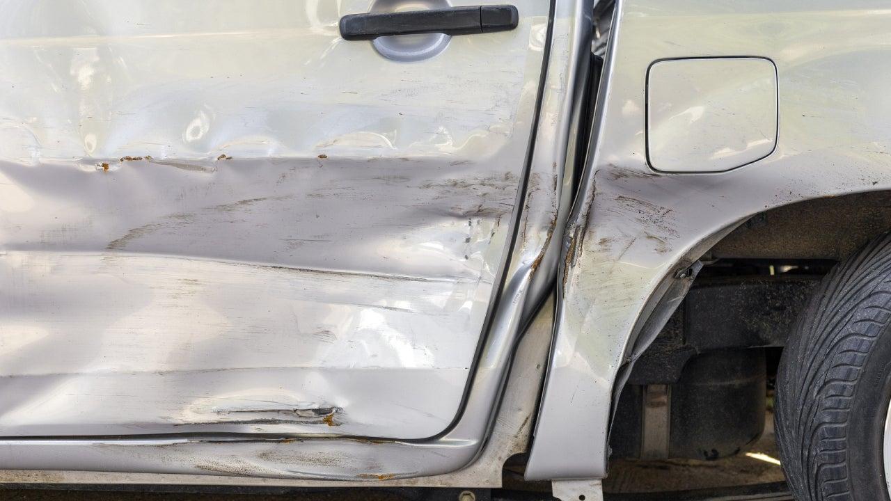 Car crash. Beside the light grey color pick up car have scratch from damage. Close up scratch