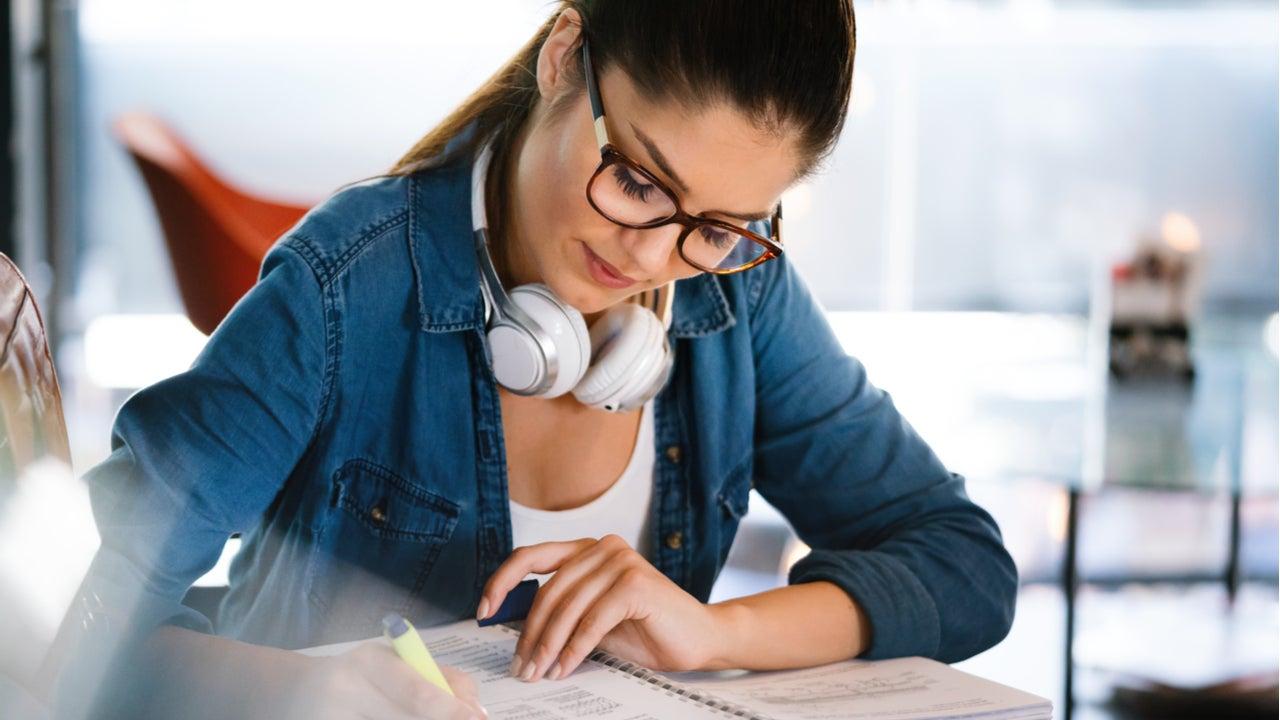 Woman studies with headphones
