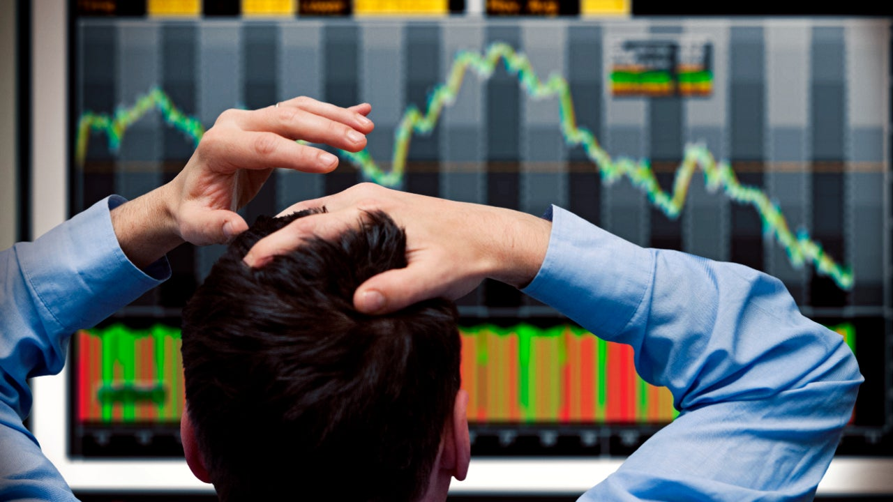 A man watches a falling stock chart