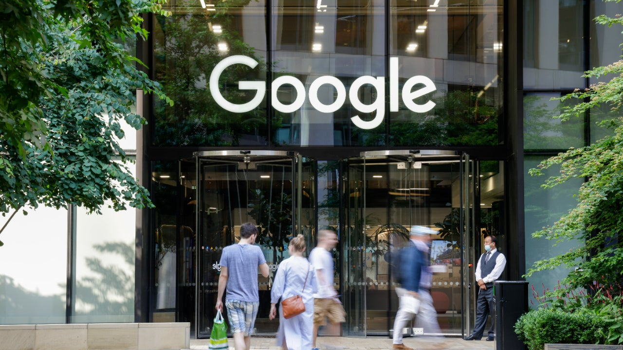 A picture of people walking into a Google building