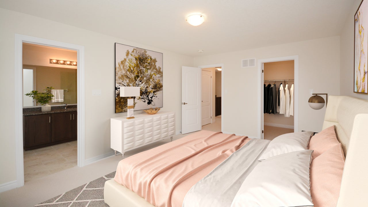 A digitally-staged bedroom with light pink bedspread