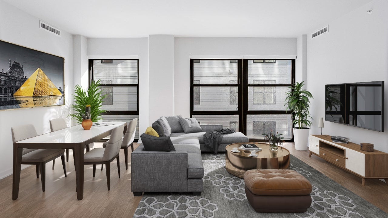 A digitally-staged living room with gray and brown accents