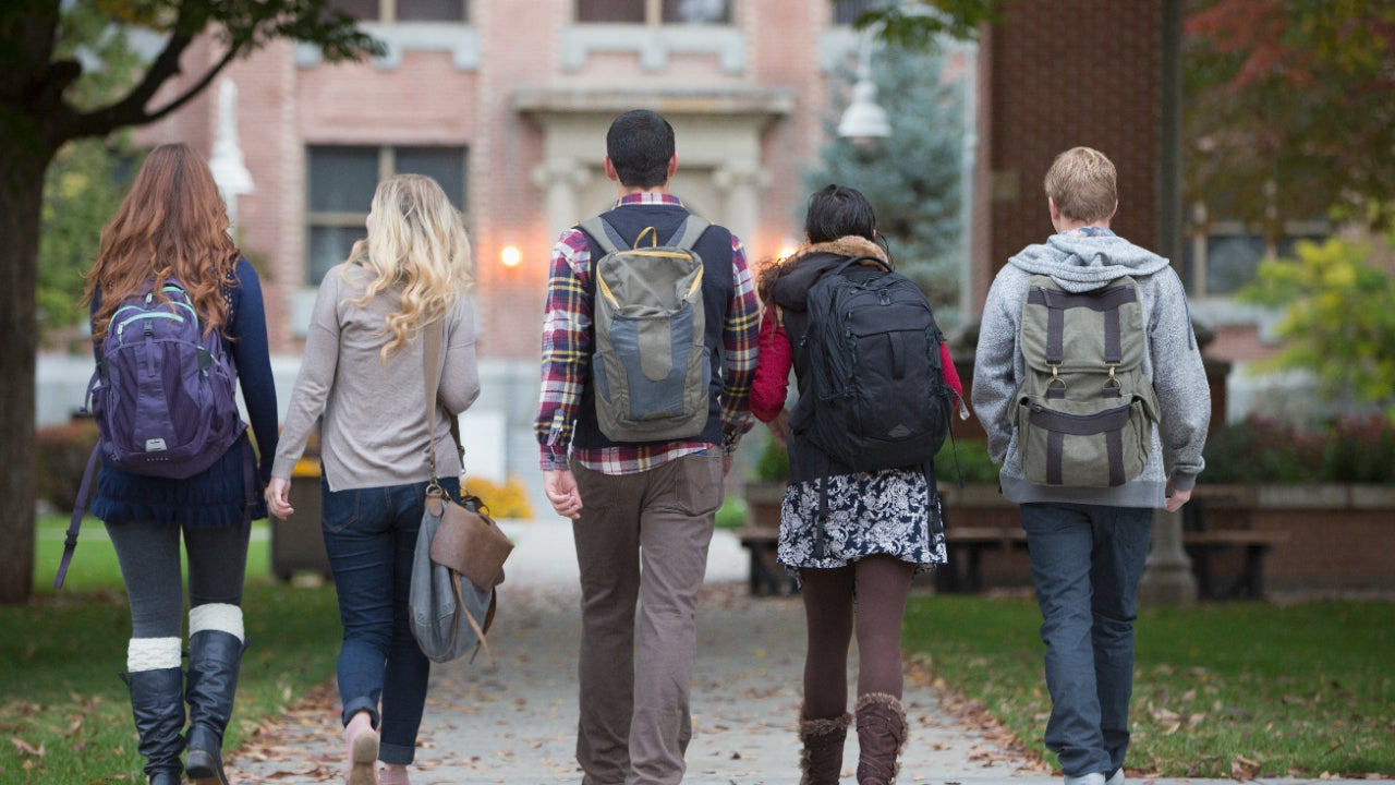 Group of college students walking on campus