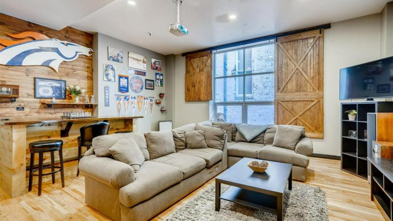 Denver bachelor pad with sports memorabilia all over the wall