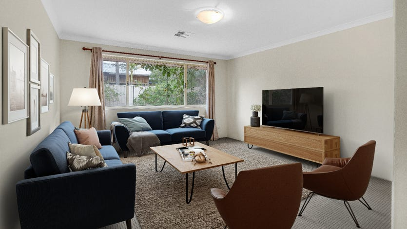 A living room digitally-staged with brown and blue accents