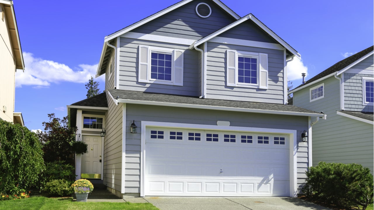 The exterior of a two-story single-family home with attached garage and driveway