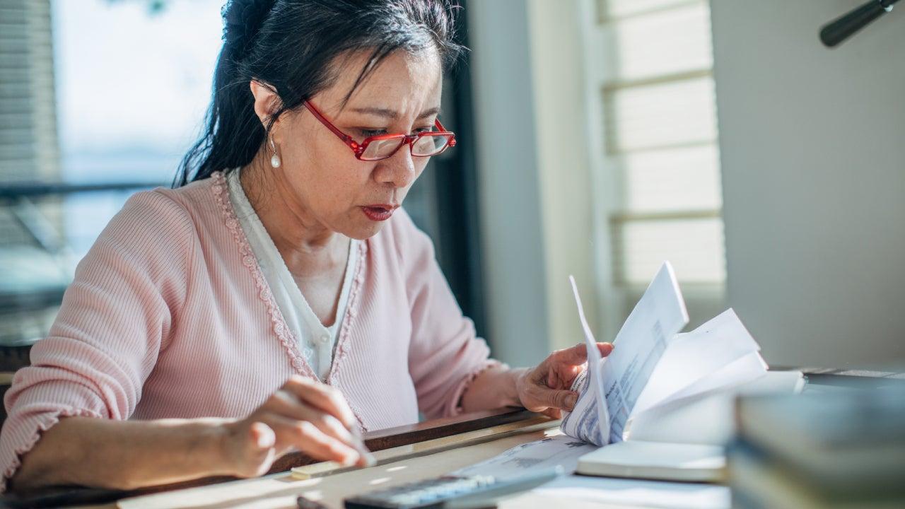 Senior woman doing finances at home