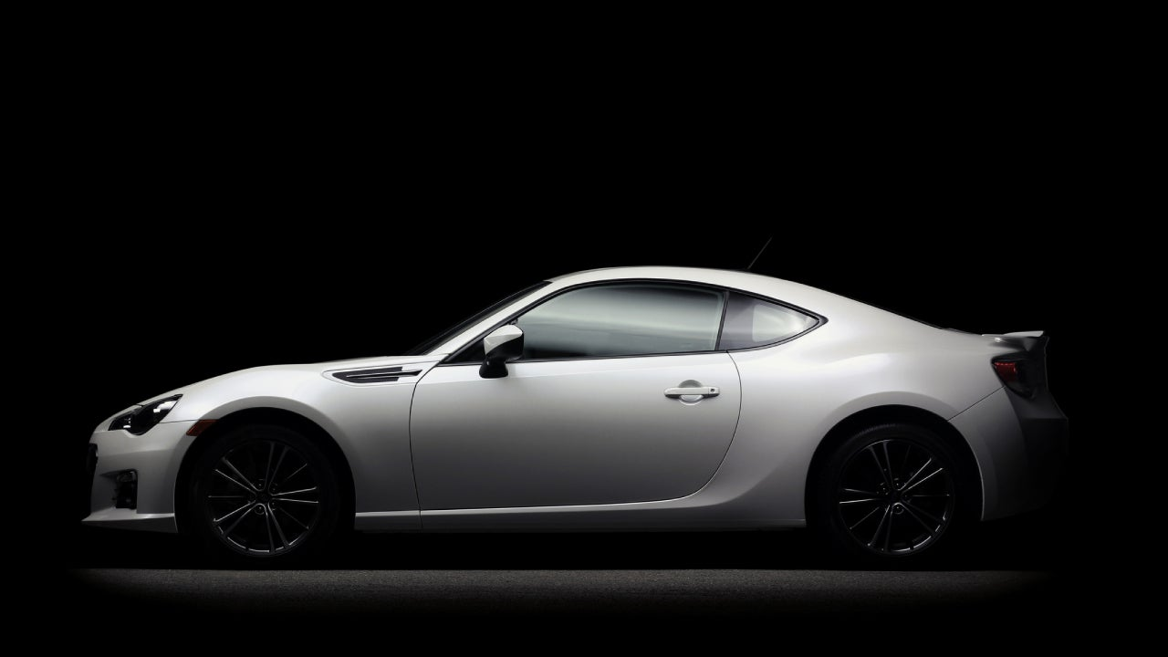 White Subaru car on a black background