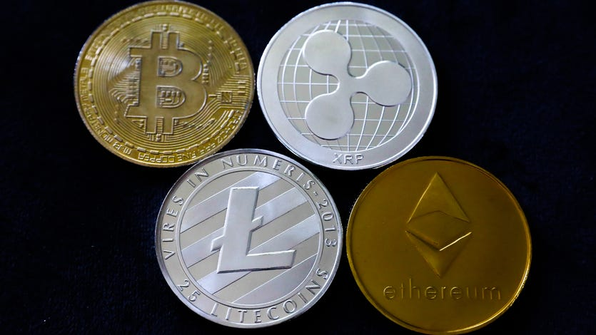 An artist's depiction of a few cryptocurrency coins