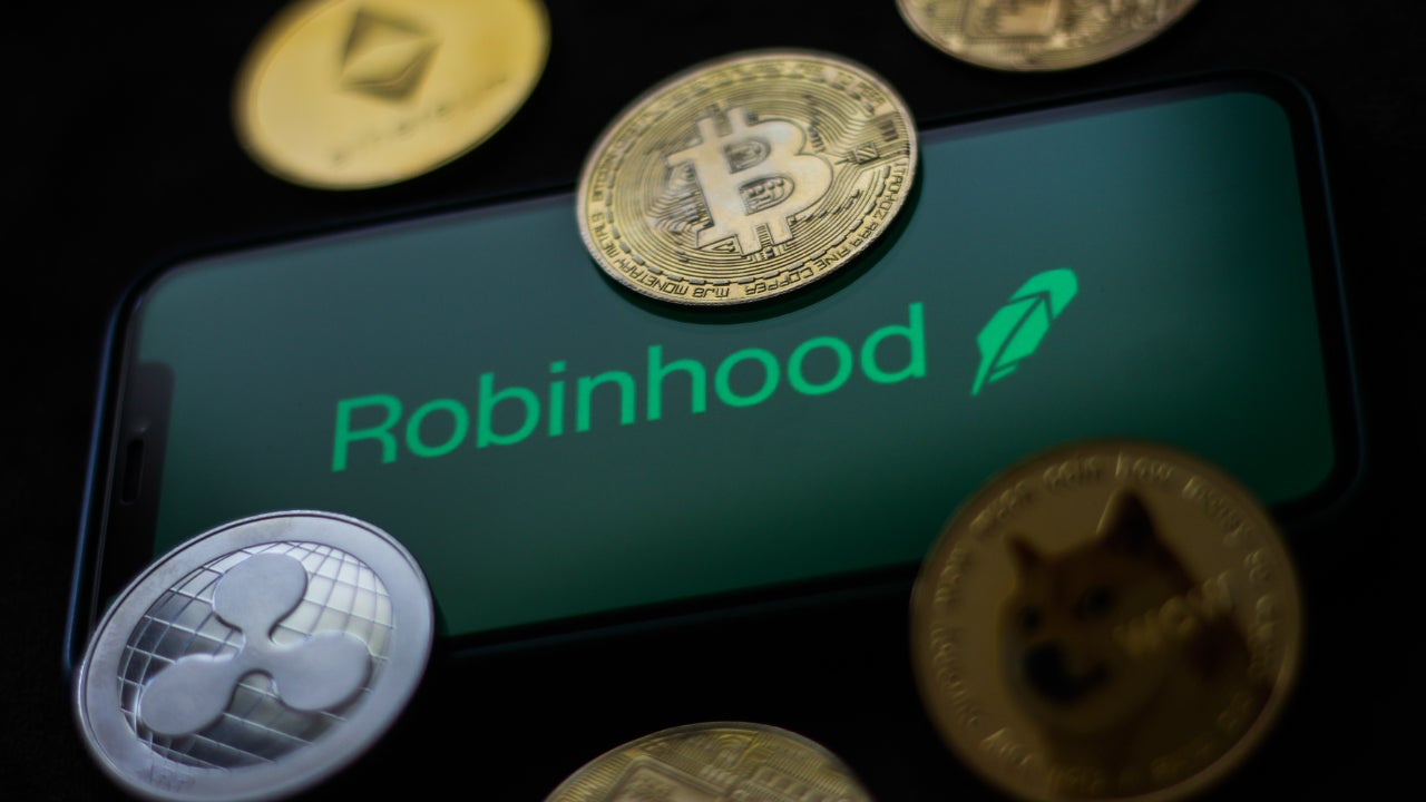 A Robinhood logo with physical versions of crypto coins