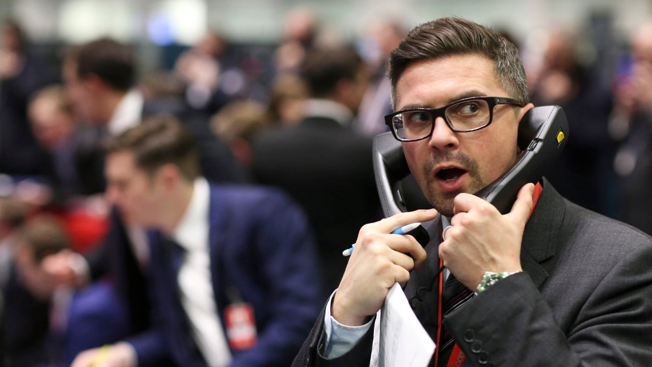 Trader on the phone