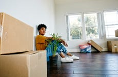 Young Black woman moving into a new apartment