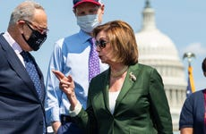 Speaker of the House Nancy Pelosi speaks with Chuck Schumer in front of the U.S. Capitol