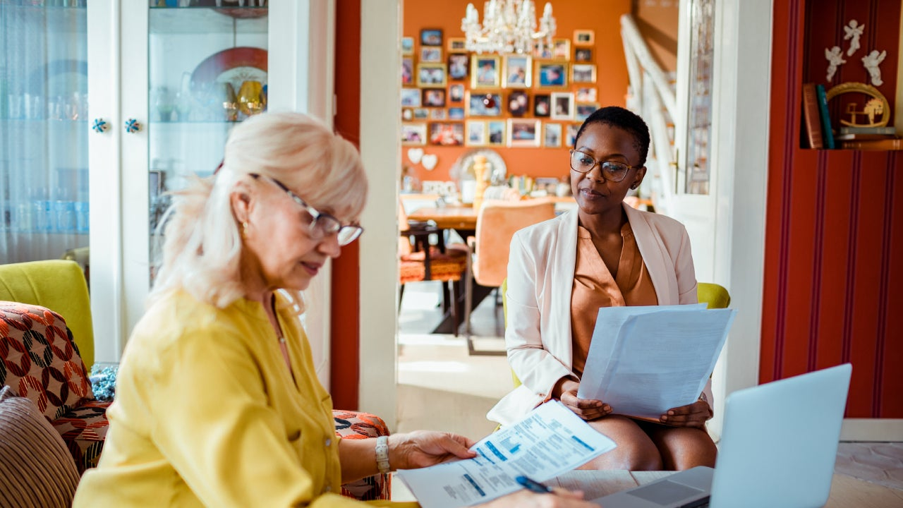 Financial advisor helping a senior woman with her finances
