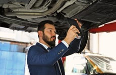Take a directly below photo at the auto repair shop for insurance
