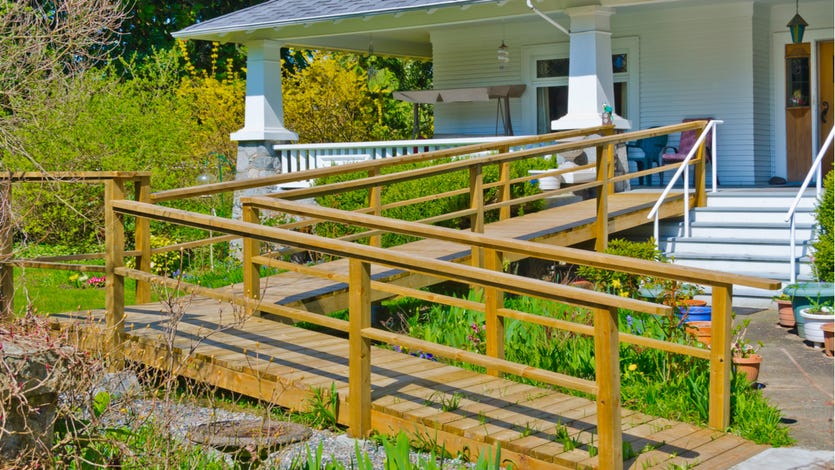 Home with wooden wheelchair ramp