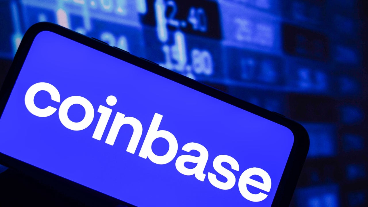A phone with the Coinbase logo on it