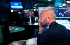 Trader looks at screen at NYSE