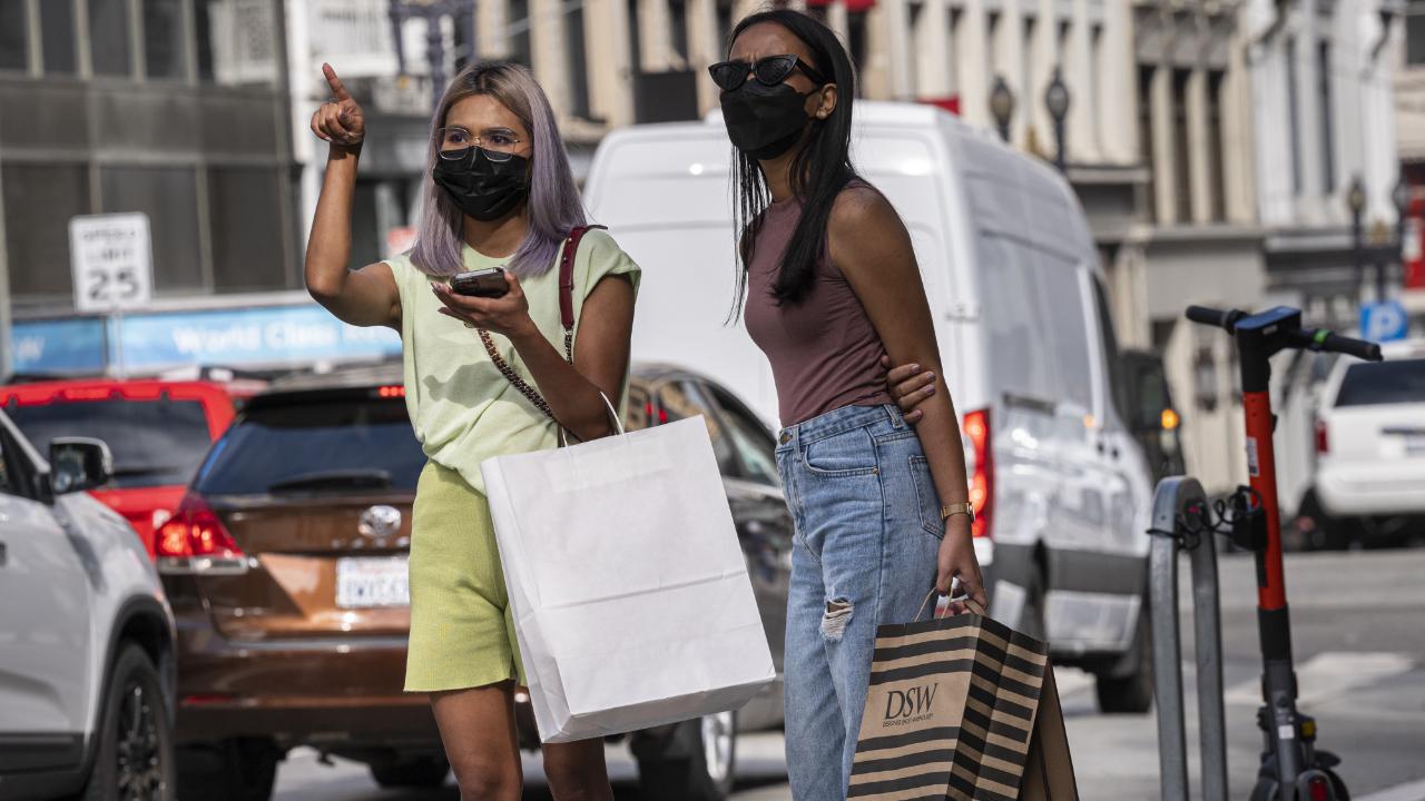 Pedestrians carry shopping bags in San Francisco, California.