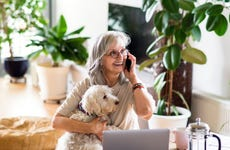 Woman on cell phone with dog