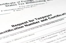 application form w-9, request for taxpayer identification number tin and certification close up shot