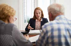 Businesswoman explaining investment plan to retired couple
